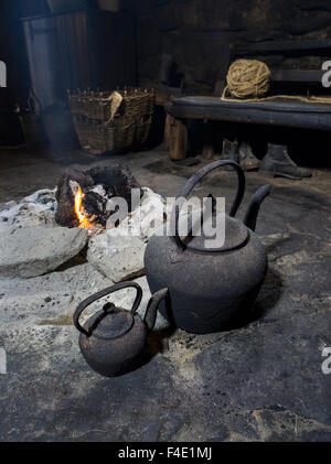 Arnol Blackhouse No 42 on the Isle of Lewis. Open peat fire in the living room, kitchen. (Large format sizes available) - Stock Photo