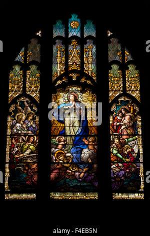 USA, Arizona, Bisbee. Stained glass window in St. Patrick's Roman Catholic Church. (National Register of Historic - Stock Photo