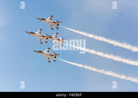 USA, Arizona, Glendale, Luke Air Force Base. Four F-16 Thunderbirds fly in close formation. Credit as: Wendy Kaveney - Stock Photo