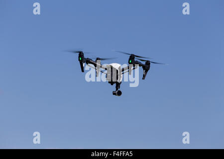 Quadcopter Drone DJI Inspire with camera for aerial photography and videos. - Stock Photo