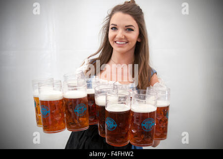 Helen Cawsey from Crosby in Liverpool, shows her skills at carrying 10 steins at the Oktober Beer Festival at Exchange - Stock Photo