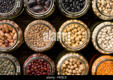 top view of various dried legumes in jars - Stock Photo