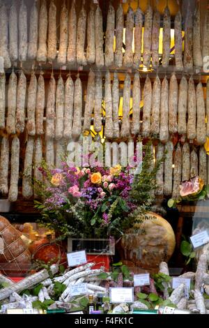 salami hanging in a shop window in Bologna Italy - Stock Photo