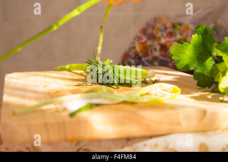 Parsley and dill on wooden cutting board. Preparation of vegetable salad/fresh vegetables/fresh salad with olive - Stock Photo