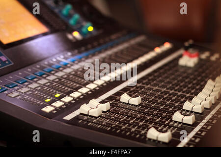 Audio console - Close up of a sound mixing board - Stock Photo
