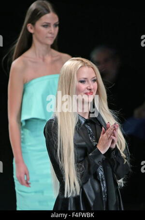 MOSCOW, RUSSIA. OCTOBER 17, 2015. Designer Eleonora Amosova (front) seen during a catwalk show for her collection - Stock Photo