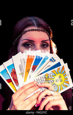 Portrait of fortune teller with tarot cards - Stock Photo