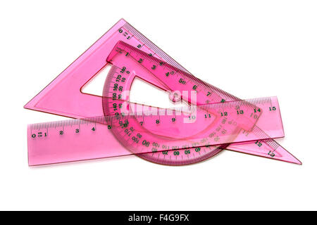 Pink rulers isolated on white background - Stock Photo
