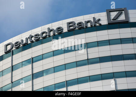 A logo sign outside of an office building occupied by Deutsche Bank in Amsterdam, Netherlands on October 4, 2015. - Stock Photo