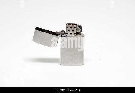 Open brushed metal lighter isolated on white background - Stock Photo