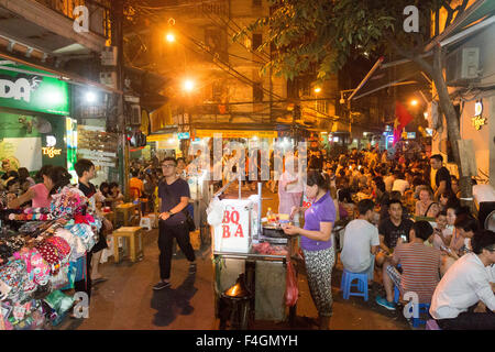 packed old quarter of Hanoi in the evening, popular with tourists and locals to enjoy beer and street food,Hanoi,Vietnam - Stock Photo
