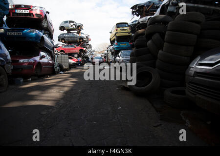 Junked Automobiles Stacked In A Junkyard Crushed For Use