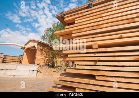 Wood planks stacked at lumber mill in Ontario, Canada - Stock Photo