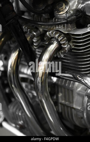 Detail of a motorcycle exhaust pipes and cylinders.. - Stock Photo