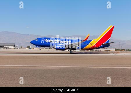 Southwest Airlines Boeing 737 landing on runway 25L at Las Vegas McCarran International Airport - Stock Photo