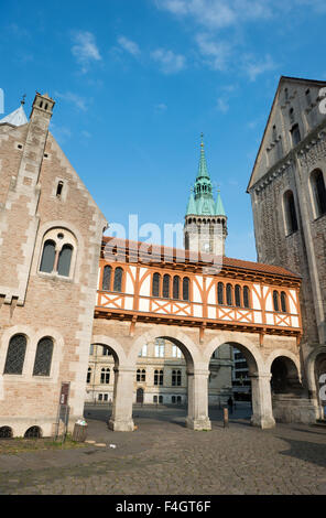 City hall (Rathaus) tower and Brunswick Cathedral on the Burgplatz in Braunschweig, Germa - Stock Photo