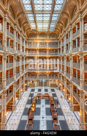 The beautiful interior of the George Peabody Library, a part of Johns Hopkins University, in Baltimore, Maryland. - Stock Photo