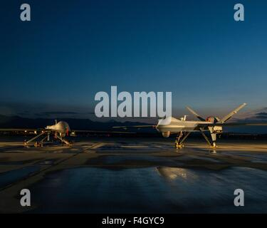 A MQ-9 Reaper and MQ-1 Predator UAV drones on the flight line at Creech Air Force Base May 5, 2015 in Indian Springs, - Stock Photo