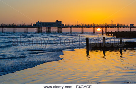 Sunset over the sea at Worthing Pier in Worthing, West Sussex, England, UK. - Stock Photo
