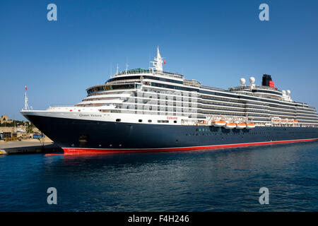 The Cunard cruise liner Queen Victoria in dock at Rhodes Harbour, on the Greek island of Rhodes, Greece. - Stock Photo