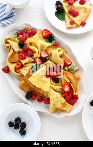 crepes with fresh berries and honey, top view - Stock Photo