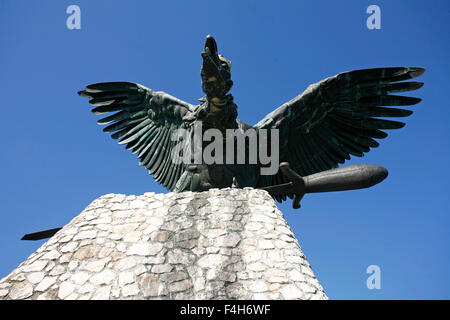 Statue of the famous hungarian legendary Turul bird against blue sky - Stock Photo