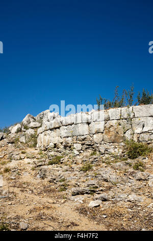 The walls of Pontikokastro, the ruined hilltop castle above the old village of Chorio, on the Greek island of Symi. - Stock Photo