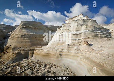 Rock formation of eroded volcanic rock on the coast nearby Sarakiniko beach in the north of Milos island. - Stock Photo