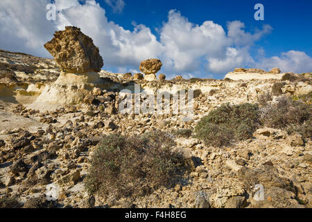 Rock formations of eroded volcanic rocks nearby Sarakiniko beach in the north of Milos island. - Stock Photo