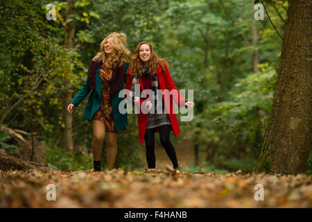 Aberystwyth Wales UK., Sunday 18 October 2015  Two happy smiling laughing young women (Iulia Nicola and Rhian Daniell) - Stock Photo