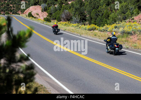 Motorcycle riders on paved road; North Central Colorado; USA - Stock Photo