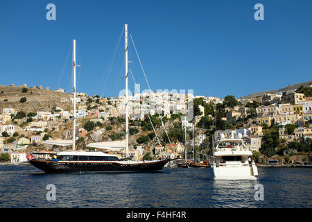 A twin masted sailing ship in Yialos harbour, on the Greek island of Symi. - Stock Photo