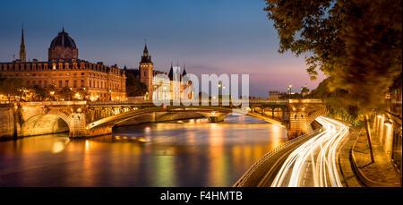 Seine River at Dusk with Pont Notre Dame and the Conciergerie on Ile de la Cite, Paris, France. - Stock Photo