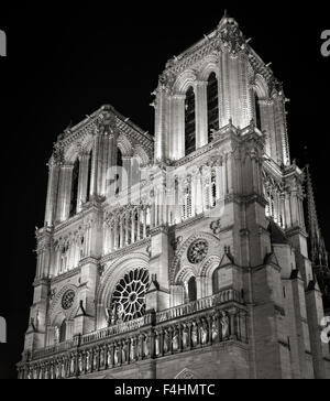 Towers and Facade of Notre Dame de Paris Cathedral illuminated at night, Ile de la Cite, France. French Gothic Architecture