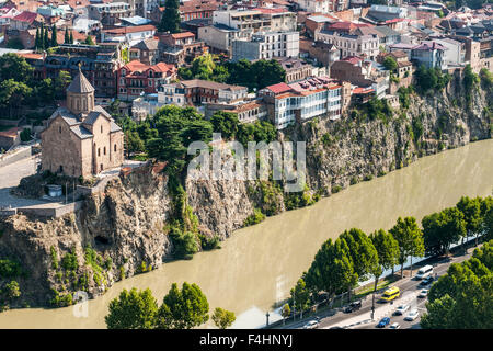 The Metekhi church and buildings lining the Kura River in Tbilisi, the capital of Georgia. - Stock Photo