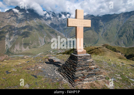 Cross at the Gergeti Trinity Church in the Caucasus mountains on northern Georgia. - Stock Photo