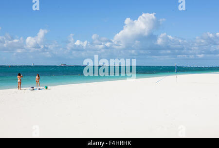 Girl friends take a photo at the main beach on Isla Mujeres, an island off Cancun, Quintana Roo, Mexico. - Stock Photo