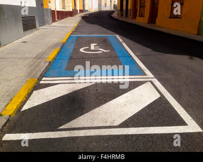 Disabled parking sign place on old downtown steet - Stock Photo