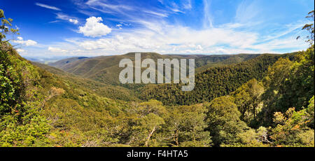 Barrington tops national park devils hole lookout on a summer sunny day looking at mountain valley covered by woods - Stock Photo