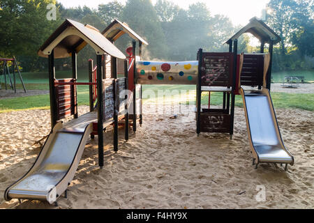 A deserted children's playground in early morning - Stock Photo