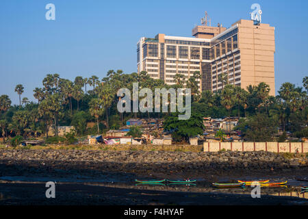 The most possible contrast, a fishermen slum area just behind the very luxurious and expensive Taj Land's End Hotel - Stock Photo