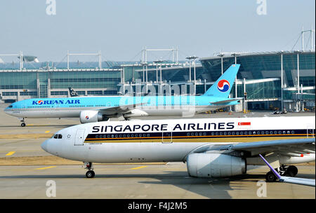 Airbus A 330-300 of Singapore airlines and Boeing 777 of Korean airlines Incheon international airport South Korea - Stock Photo
