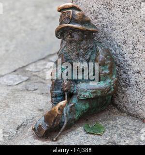 Sleepyhead dwarf on sw Mikolaja street in Wroclaw, Poland. - Stock Photo
