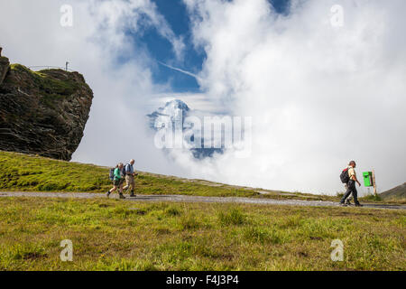Hikers on the way to Mount Eiger, First Grindelwald, Bernese Oberland, Canton of Berne, Switzerland, Europe - Stock Photo
