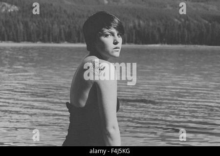 Young beautiful woman traveling in Jasper, Canada in black and white - Stock Photo