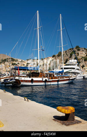 A twin masted gulet  in the harbour at Yialos, on the Greek island of Symi. - Stock Photo