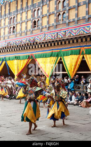 Monks in costume and animal masks performing ceremonial dance at Paro Tsechu (annual festival), Paro Dzong, Paro, - Stock Photo