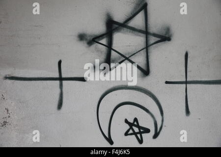 Religious symbols tagged on a wall, Montrouge, Hauts-de-Seine, France, Europe - Stock Photo