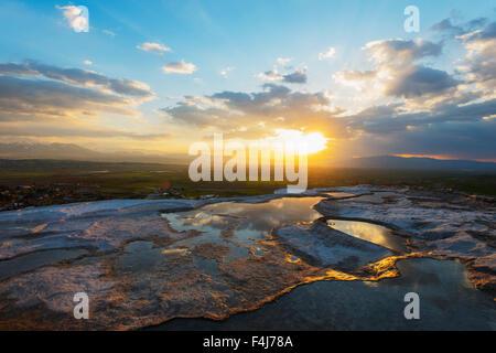 White travertine basins at sunset, Pamukkale, UNESCO World Heritage Site, Anatolia, Turkey, Asia Minor, Eurasia - Stock Photo