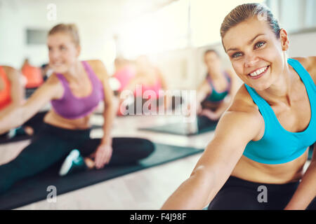 Fit and healthy woman in a fitness class, colorful sportswear, fitness, aerobics, sport concept - Stock Photo